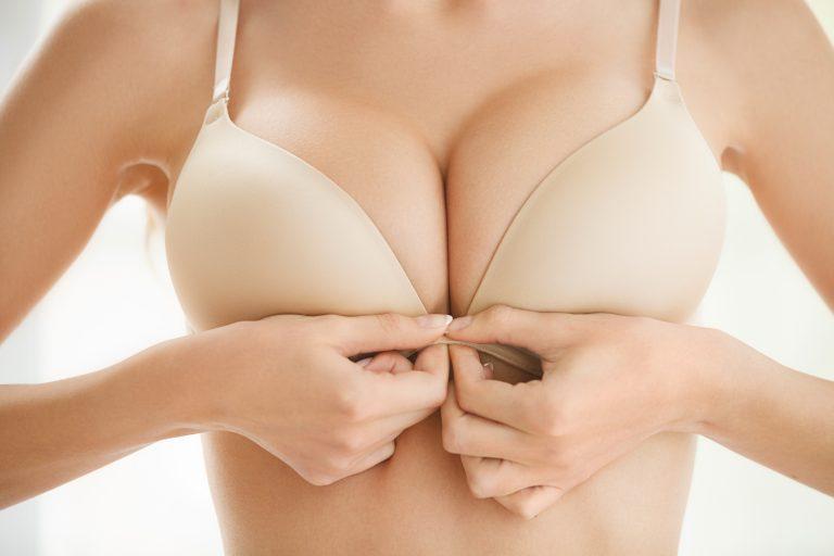 woman holding bra