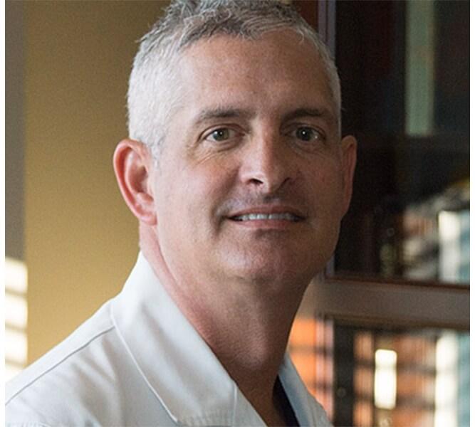 Dr. Christopher Livingston