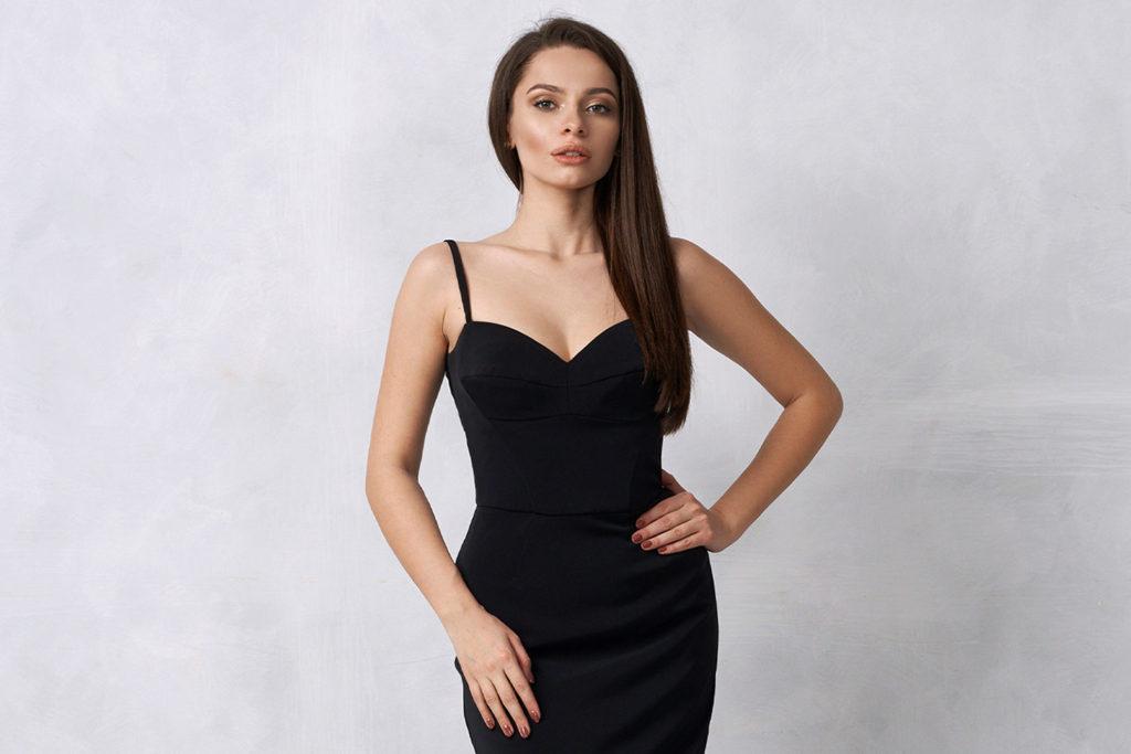 woman posing in black dress