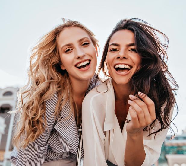 two women laughing smiling