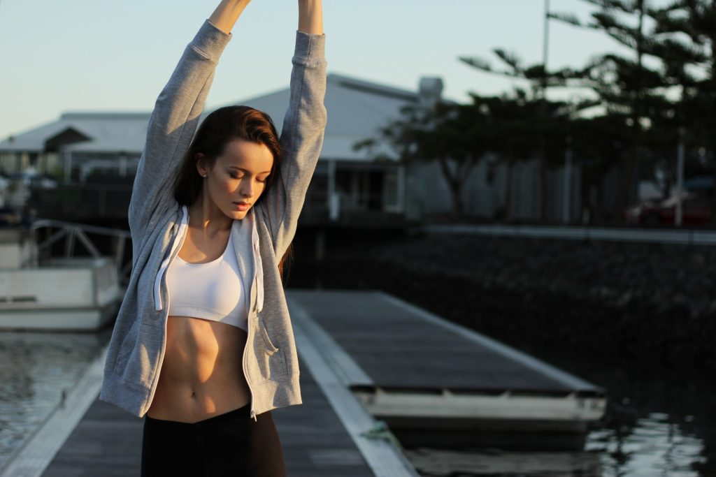 woman in exercise clothes stretching