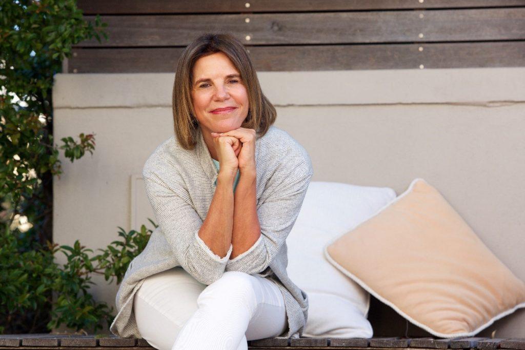 woman sitting down posing smiling
