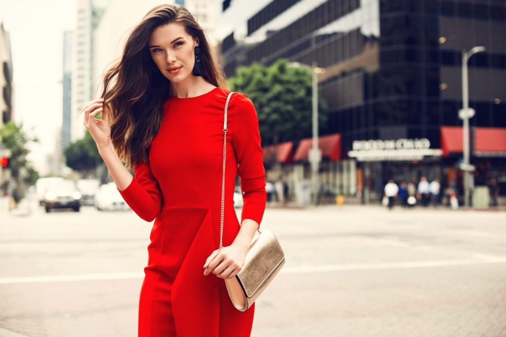 woman in red dress looking away