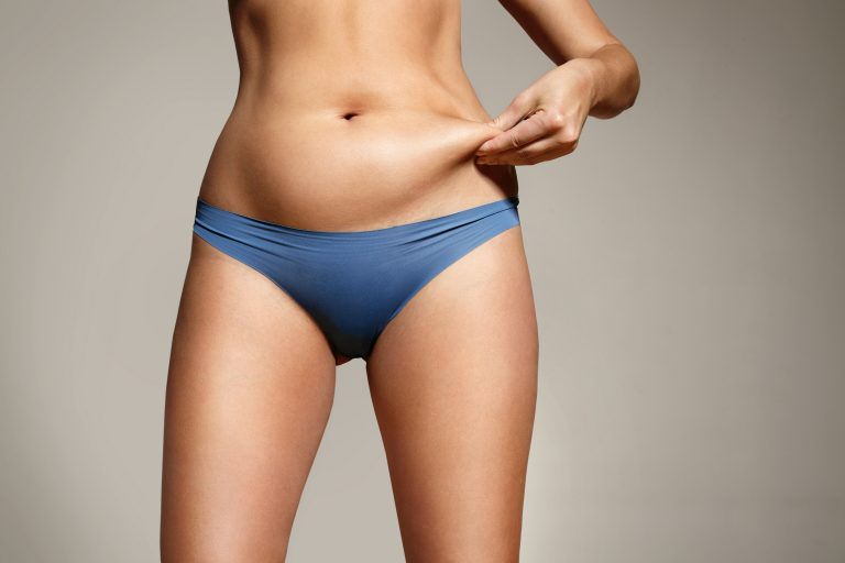 woman holding tummy