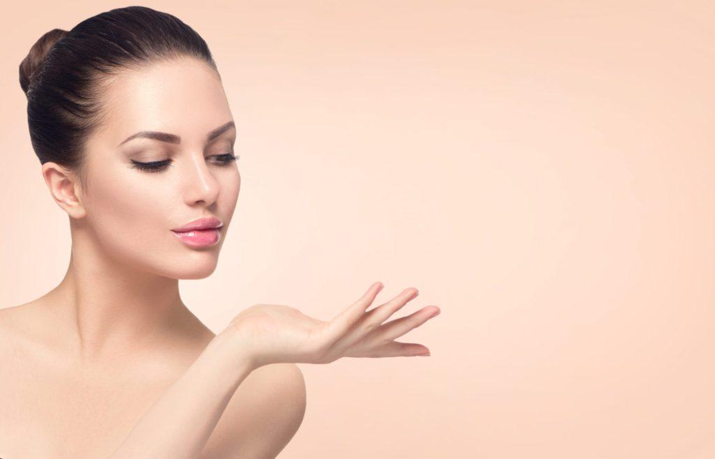 woman posing looking at hand
